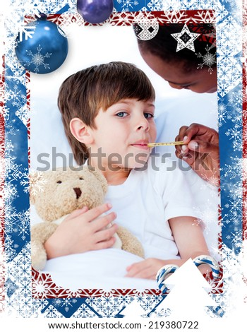 Serious nurse taking childs temperature against christmas themed frame - stock photo