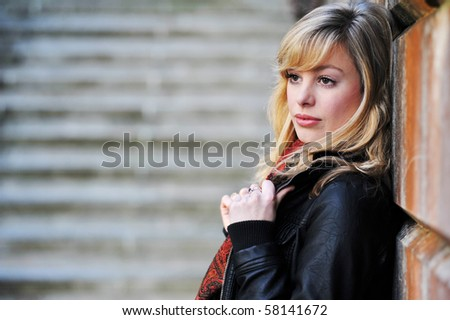 Serious Outdoor Portrait Of Young Woman
