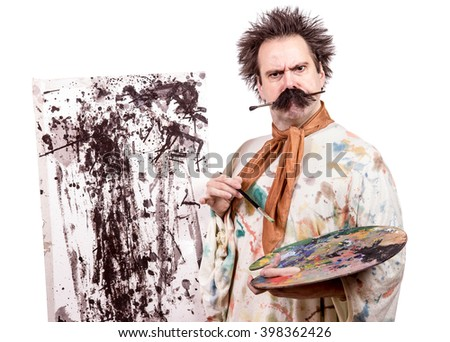 serious painter paints on canvas - stock photo