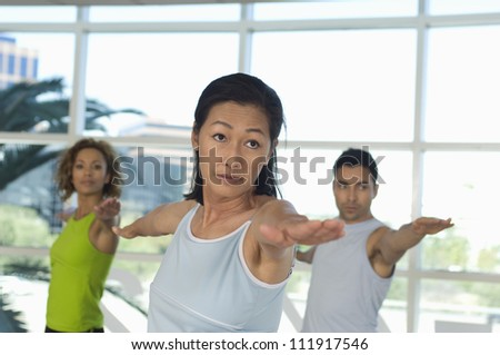 Serious people practicing yoga - stock photo
