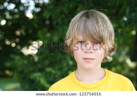 Serious preteen boy - stock photo