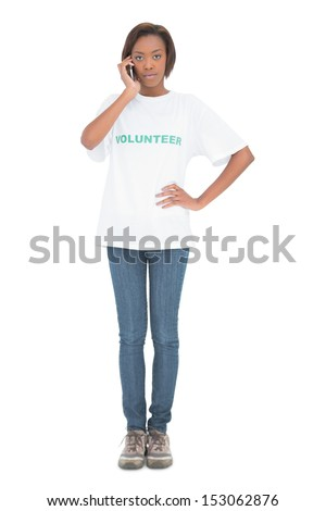 Serious pretty volunteer having a phone call on white background - stock photo