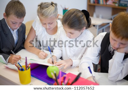 Serious pupils writing task in the classroom