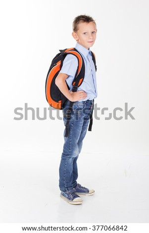 Serious school boy with bag isolated on white background - stock photo