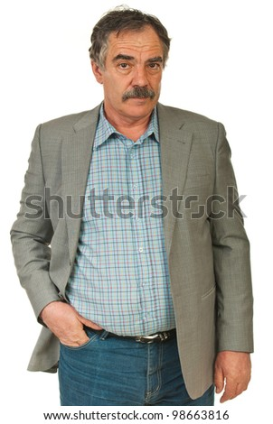 Serious senior business man standing with hand in jeans pocket isolated on white background