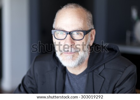 Serious Senior Man Looking At The Camera - stock photo