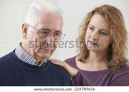 Serious Senior Man With Adult Daughter At Home - stock photo