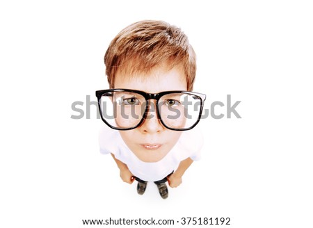 Serious smart boy wearing big glasses staring at the camera. Education. Studio shot. Isolated over white. - stock photo
