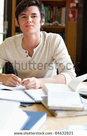 Serious student working in a library