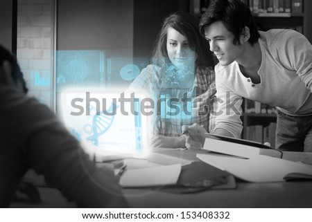 Serious students analysing dna on digital interface in university library - stock photo