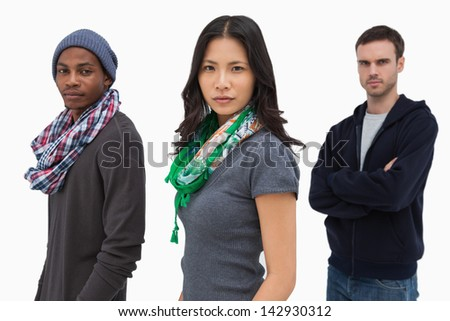 Serious stylish young people in a row on white background - stock photo
