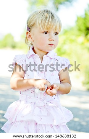 serious sweet  toddler girl outdoors - stock photo