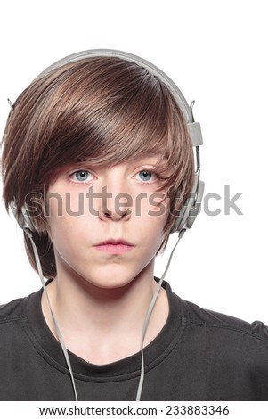 serious teenage boy with headphones, isolated on white - stock photo
