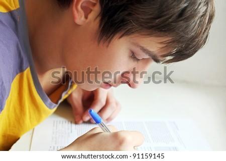 serious teenager writing close up - stock photo