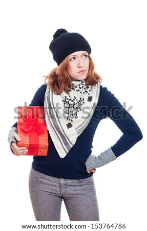 Serious winter woman holding present, isolated on white background. - stock photo