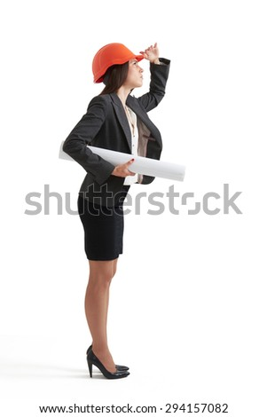 serious woman architect in orange hardhat holding plan and looking up. isolated on white background - stock photo
