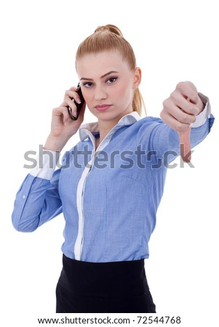 Serious woman gesturing thumbs down over white, isolated - stock photo