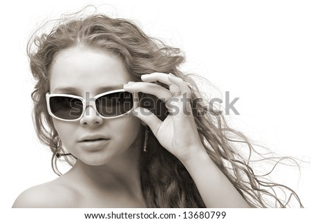 serious woman in sunglasses - stock photo