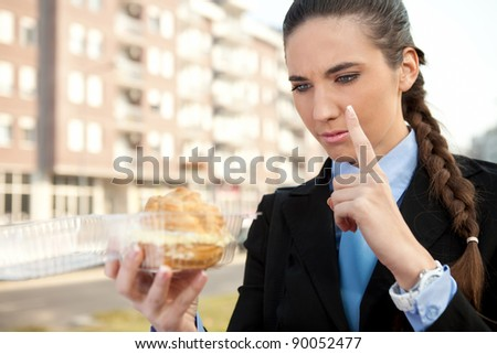 serious woman looking in unhealthy  food with finger up - stock photo