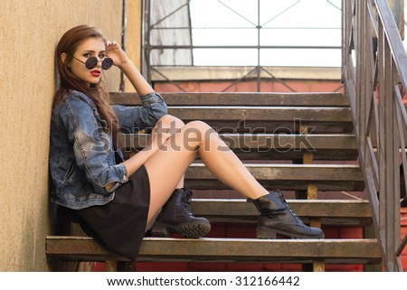 serious woman thinker sitting on steps