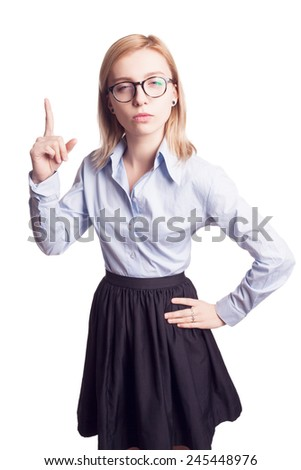 Serious young blond woman with glasses shows finger up. Isolated - stock photo