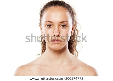 Serious young girl without makeup - stock photo