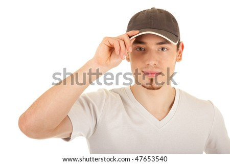 Serious young man in a brown hat is touching the hat peak