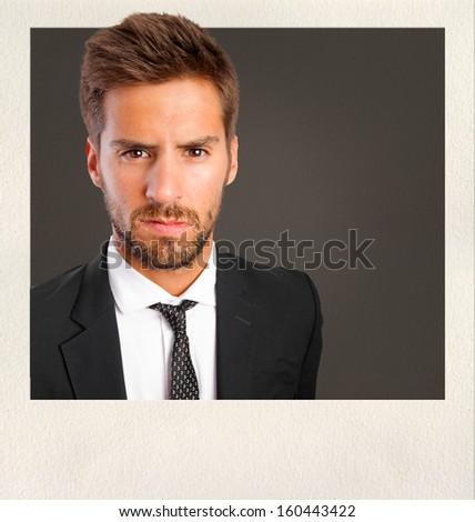 serious young man on photo frame