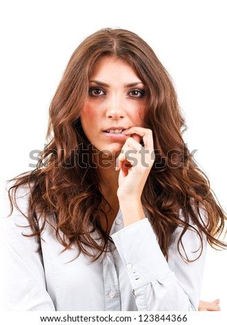 Serious young woman thinking about something - stock photo