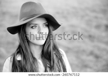 Serious Young Woman - This is a black and white portrait of a beautiful young woman looking off in the distance.  - stock photo