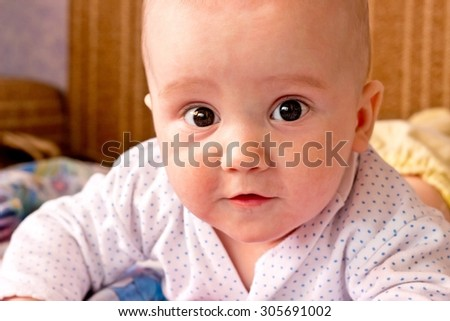 Seriously adorable boy close up portrait - stock photo
