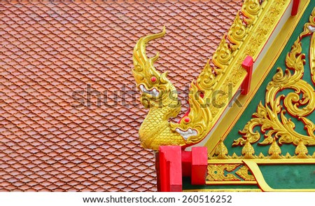 Serpent decoration on Thai temple roof - stock photo