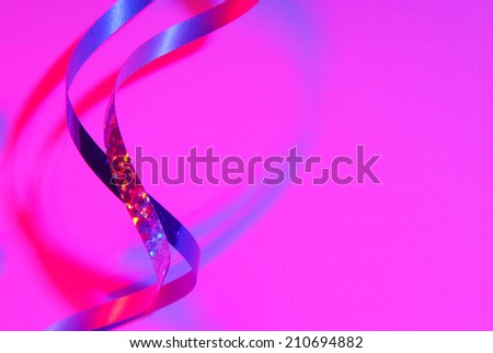 serpentine confetti  and  pink purple lighting
