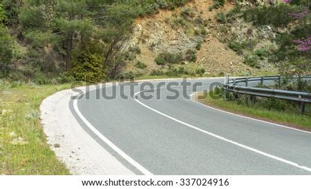Serpentine highway turn with metal rails. Cyprus.  - stock photo