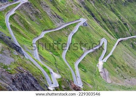 serpentine mountain road in Italian Alps, Stelvio pass, Passo dello Stelvio, Stelvio Natural Park - stock photo