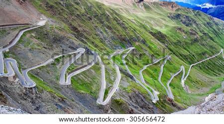 serpentine mountain road in Italian Alps, Stelvio pass, Passo dello Stelvio, Stelvio Natural Park - stock photo