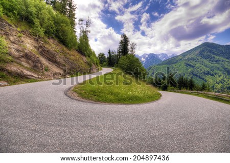 Serpentine mountain road in the Austrian Alps - stock photo