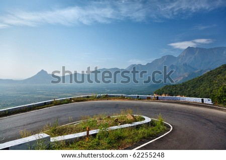 Serpentine road in mountains. Tamil Nadu, India - stock photo