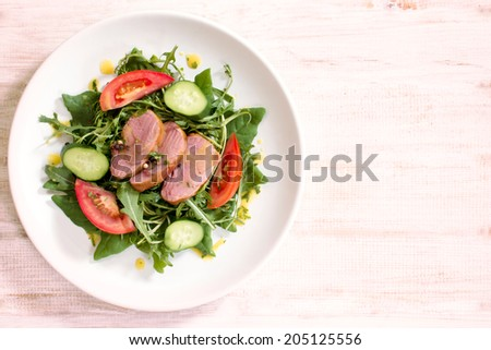 Served a dish of vegetables and delicacies meat on a plate,blank space on the right side - stock photo