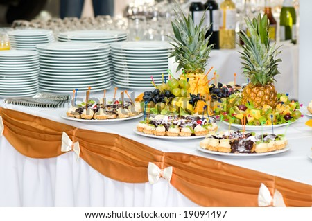 served banquet dessert table, sliced fruits, cakes
