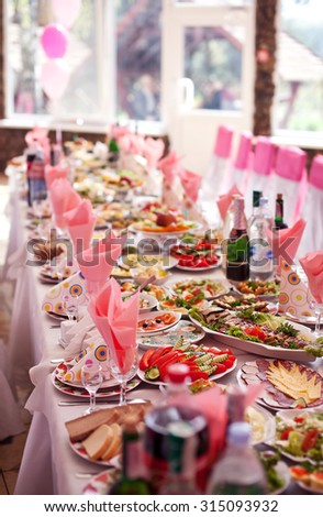 Served banquet table with alcholoh drinks. - stock photo