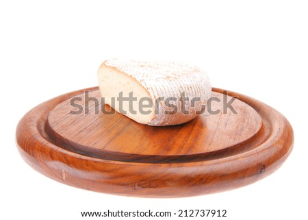 served cheese triangle on wood over white - stock photo