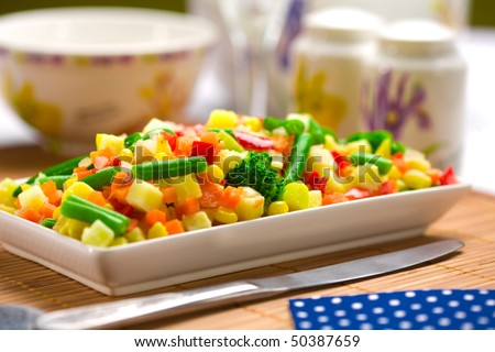 Served chopped vegetables mixture. Potato, green bean, broccoli, corn, carrot, onion and sweet pepper. - stock photo