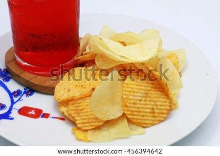 Served crispy potato chips with red water