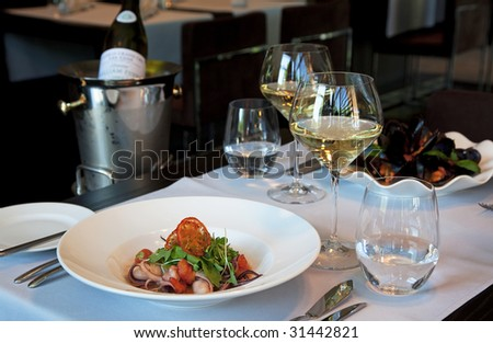 Served dinner with seafood and white wine - stock photo