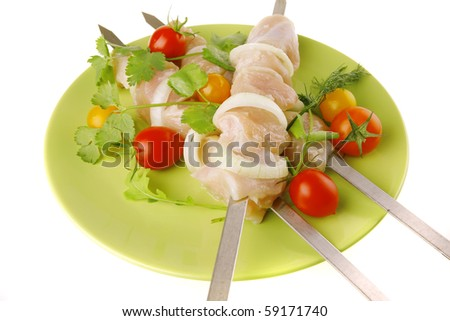 served fresh chicken kebabs on dark plate