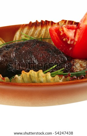 served meat with vegetables on white background