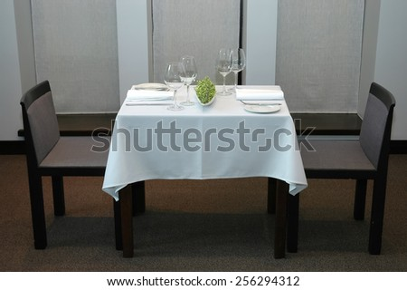 Served restaurant table for two - stock photo