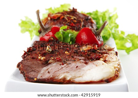 served roast beef steak on white plate with salad - stock photo