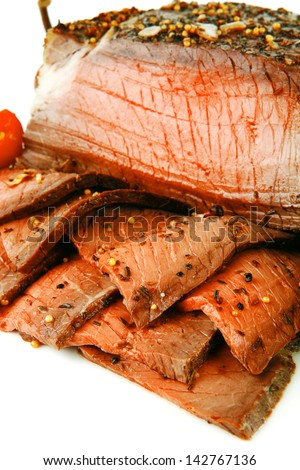 served roast slice with pepper on white - stock photo